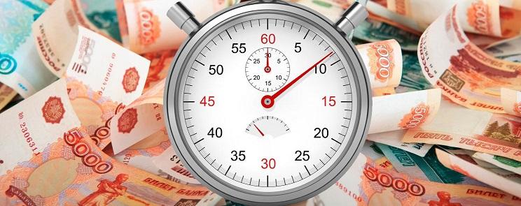 Часы на фоне денежных купюр