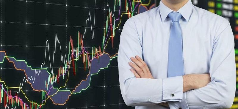 Биржевой торговец на фоне графиков